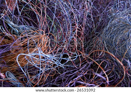 Telephone wires gathered for recycling. There is plastic and copper to recover. - stock photo