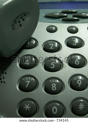 telephone with receiver and buttons - stock photo