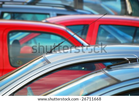 Telephoto view of parked cars in parking lot - stock photo