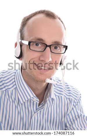 Telesales - Portrait of helpful man with headset smiling at camera - stock photo