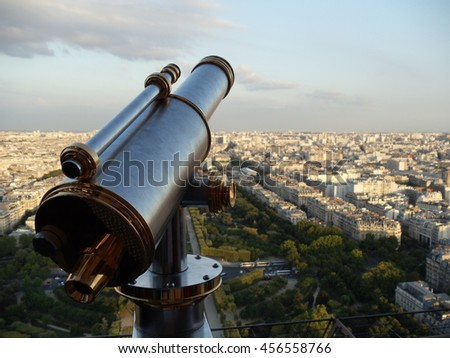 Telescope at Eiffel Tower observation deck overlooking landscape panorama of the Paris France The most visited tourist point and tourist destination city in Europe