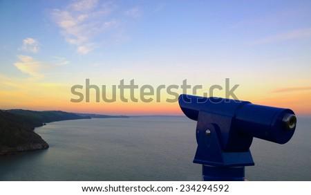 Telescope by the coast in Babbacome, Torquay, Devon - stock photo