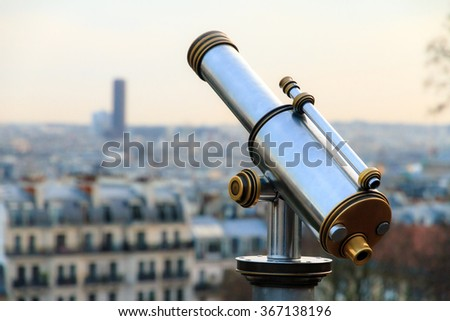 Telescope looking out over the skyline of Paris, France - stock photo