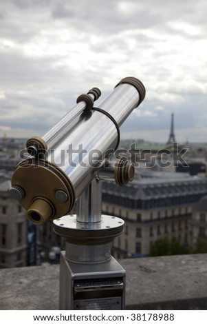 Telescope on the roof in Paris with the Eiffel Tower in background - stock photo