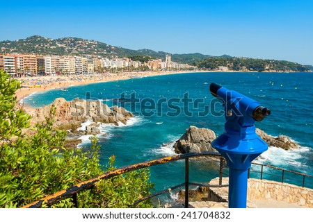 Telescope overlooking beach in Lloret de Mar. Catalonia, Spain, Europe - stock photo