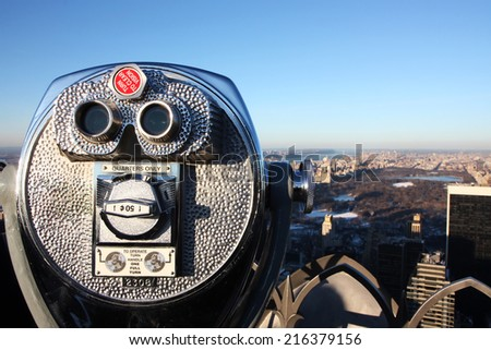 Telescope overlooking Central Park in Manhattan New York - stock photo