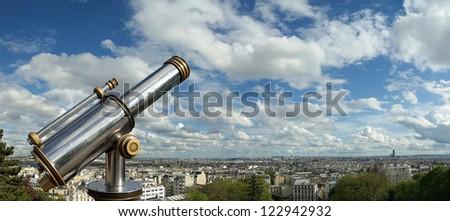 Telescope viewer and Paris skyline fom the Sacre-CÃ?Â??ur Basilica, France - stock photo