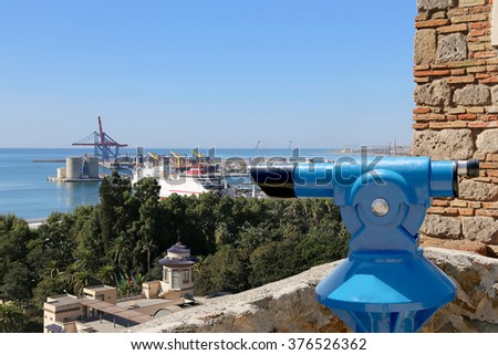 Telescope viewer overlooking the Malaga in Andalusia, Spain. Aerial view of the city  - stock photo