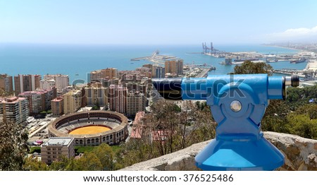 Telescope viewer overlooking the Malaga with the Plaza de Toros (bullring) from the aerial view, Spain  - stock photo