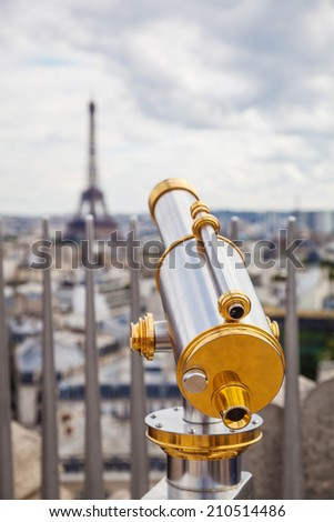 telescope with view on the Eiffel Tower in Paris, France - stock photo