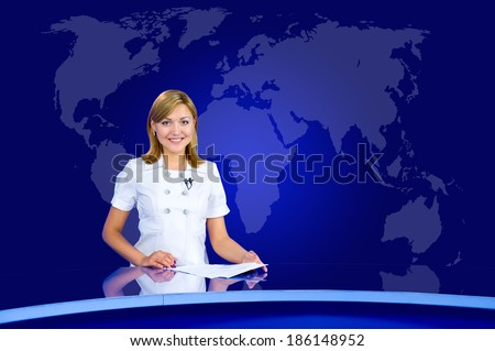 television anchorwoman at studio, with world map in the background - stock photo
