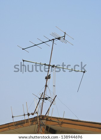 television antenna on gable house in sunlight