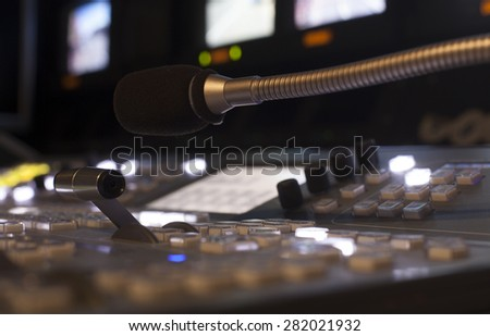 Television Broadcast Gallery  Wide shot of vision mixing panel in a television gallery.  button on the control panel television equipment  - stock photo