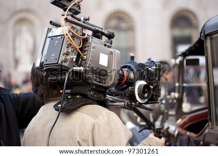Television camera recording a scene from a movie