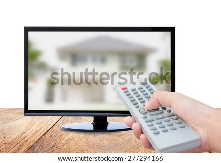 Television on wood floor and remote control TV  , concept home design - stock photo
