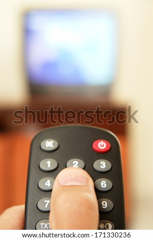 Television screen with tv remote control  in foreground..... - stock photo