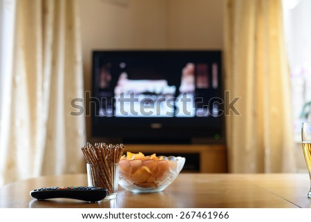 television, TV watching (movie) with snacks lying on table - stock photo - stock photo
