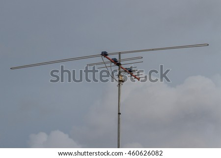 Televisions antennas in rainy day,cloudy sky background