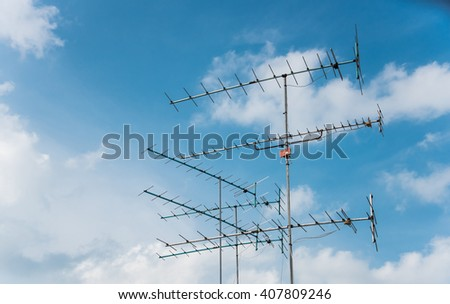Televisions antennas with cloudy sky - stock photo