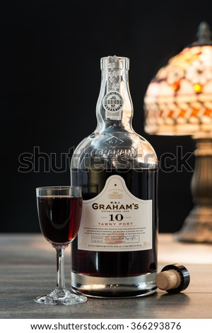 TELFORD, UK - JANUARY 22, 2016: A bottle of Graham's 10 Year Vintage Tawny Port on a black background.  The Graham's brand is owned by Symington Family Estates based in Portugal - stock photo