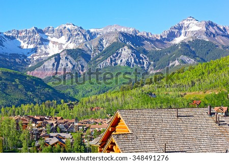 Telluride city panorama with snow mountain peaks and forestry hillsides. Beautiful town at high altitude on a sunny day in Colorado, USA. - stock photo