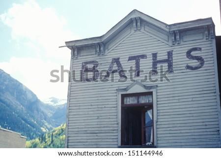 TELLURIDE, CO - CIRCA 1980's: A frontier town bath house, Telluride, CO - stock photo