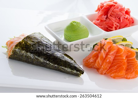 Temaki and sashimi with ginger and wasabi over white background - stock photo