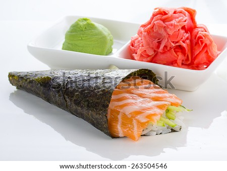 Temaki with ginger and wasabi over white background - stock photo