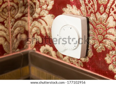 Temperature control on the wall - stock photo