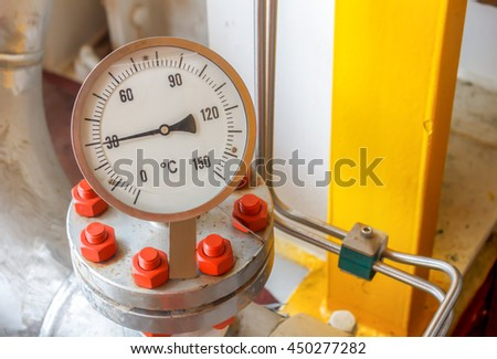 Temperature gauge connect with pipelines construction at offshore platform by industrial background concept.