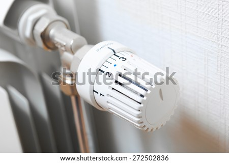 temperature knob of heating radiator - stock photo