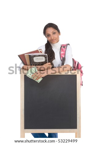 Template - Ethnic Indian college student with compositions notebook, copybooks and backpack by blackboard hold 100 (one hundred) dollar bills happy getting money to subsidies rising university cost