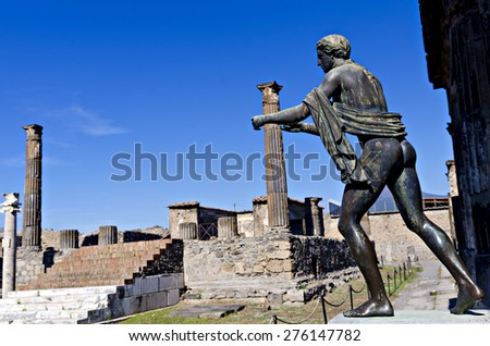 Temple and statue of Apollo in Pompeii. Pompeii was destroyed, and completely buried, during a long catastrophic eruption of the volcano Mount Vesuvius spanning two days in 79 AD. - stock photo