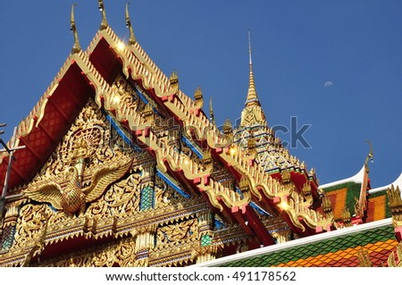 Temple gable soars into blue sky