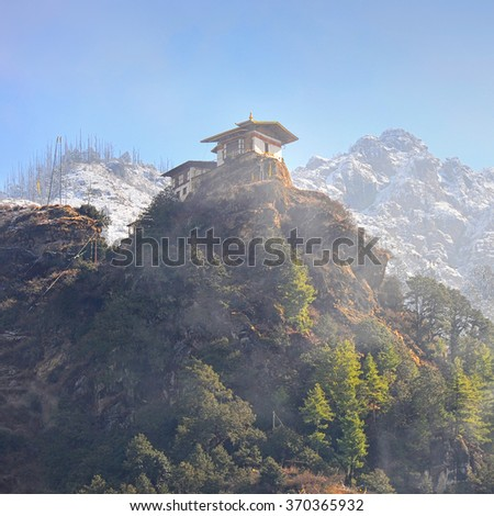 Temple in Bhutan on top of mountain on misty morning ( Paro Taktsang ) - stock photo