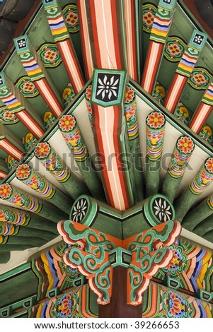 Temple Kaleidoscope - Architectural detail from a Korea palace.  The wood is painted in beautiful repeated patterns. - stock photo