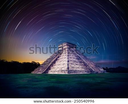 Temple of Kukulkan, pyramid in Chichen Itza, Yucatan, Mexico at night - stock photo