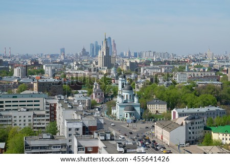 Temple of St. Sergius of Radonezh, Stalin skyscraper and office skyscrapers at sunny day in Moscow - stock photo