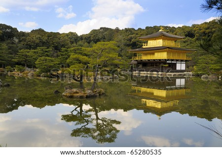 Temple of the Golden Pavilion, also known as Kinkaku-ji or Rokuon-ji, reflected in a lake. Northern Kyoto, Japan, picture taken early April - stock photo