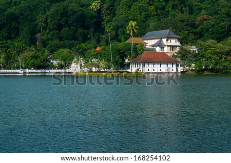 Temple of the Sacred Tooth Relic (Sri Dalada Maligawa) is a Buddhist temple situated in world heritage site, Kandy, Sri Lanka. - stock photo