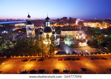 Temple of Trinity near Saltykov Bridge at night in Moscow, Russia. - stock photo
