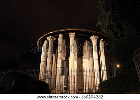 Temple of Vesta aka Temple of Hercules Victor at night, Rome, Italy
