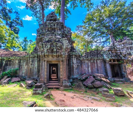 Temple old Landmark Ancient City ancient stone door and tree roots, Ta Prohm temple ruins, Angkor, Cambodia