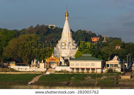 Temples of the old capital Sagaing along the Irrawaddy River in the morning sun - stock photo