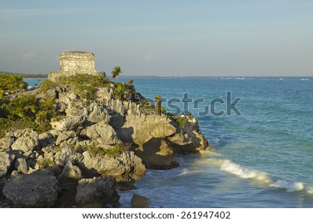 Templo del Dios del Viento Mayan ruins of Ruinas de Tulum (Tulum Ruins) in Quintana Roo, Mexico. The turquoise waters of the Caribbean Sea and beach to the right. - stock photo