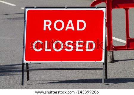 Temporary red road closed sign - stock photo