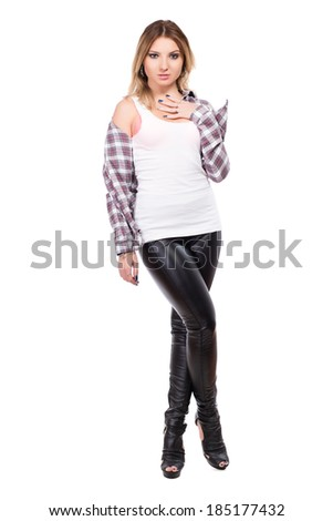Tempting blonde wearing checked shirt and black pants. Isolated on white - stock photo