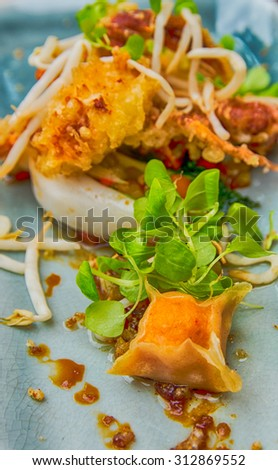 Tempura Crab with mini dumplings on a bed of oriental vegetables - stock photo