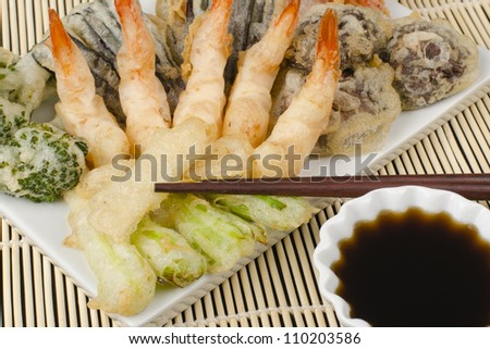 Tempura - Japanese deep fried prawns and assorted vegetables (shiitake mushrooms, peppers, spring onions, aubergine, broccoli and bamboo shoots) served with tentsuyu dipping sauce. - stock photo