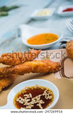 Tempura Shrimps (Deep Fried Shrimps) with sweet sauce on a wooden table - stock photo